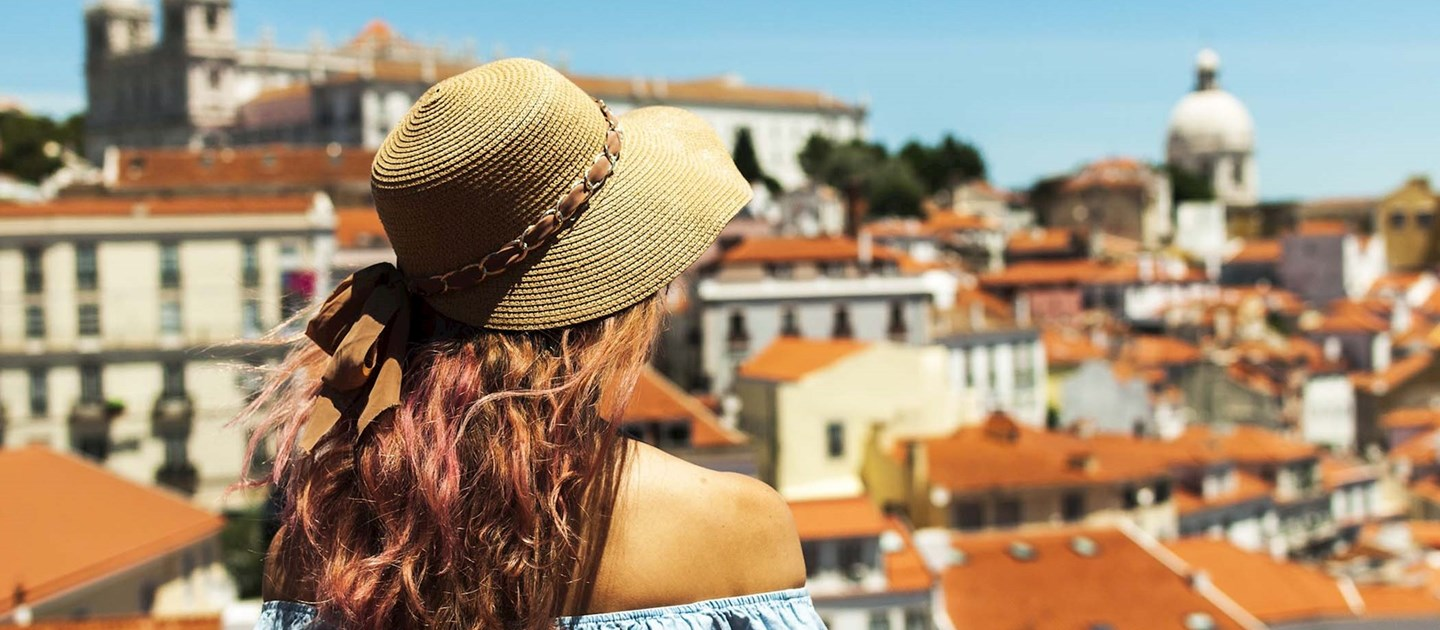 Female tourist looking over buildings in Portugal